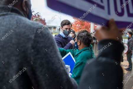 Democratic Georgia US Senate candidate Jon Ossoff greets supporters after speaking at a press conference about his opponent, Republican Senator David Perdue, in Atlanta, Georgia, USA, 30 November 2020. Ossoff is in a 05 January 2021 runoff election against Perdue. Ossoff commented on published reports of Senator Perdue's self-directed stock trading.