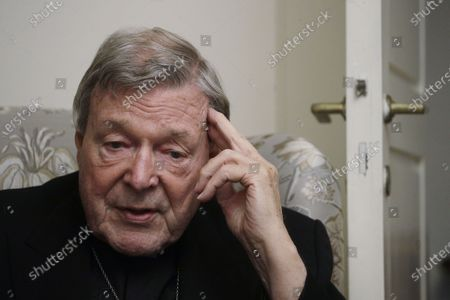 Cardinal George Pell answers a question during an interview with the Associated Press inside his residence near the Vatican in Rome, . The pope's former treasurer, who was convicted and then acquitted of sexual abuse in his native Australia, said Monday he feels a dismayed sense of vindication as the financial mismanagement he tried to uncover in the Holy See is now being exposed in a spiraling Vatican corruption investigation