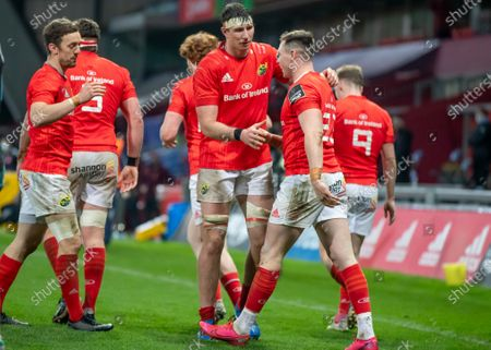 Munster vs Zebre. Munster players congratulate try scorer Sean French