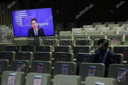 Eurogroup president Paschal Donohoe, on the screen, speaks during an online news conference following an Eurogroup video conference meeting at the European Council headquarters in Brussels