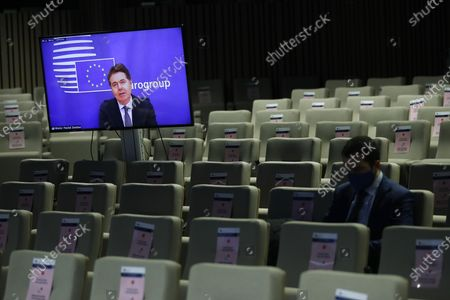 Eurogroup president Paschal Donohoe, on the screen, speaks during an online news conference following an Eurogroup video conference meeting at the European Council headquarters in Brussels, Belgium, 30 November 2020.