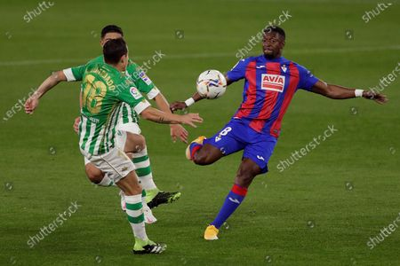 Real Betis' midfielder Jose Andres Guardado (L) vies for the ball with Eibar's midfielder Papakouli Diop (R) during the Spanish LaLiga soccer match between Real Betis and SD Eibar held at Benito Villamarin stadium, in Seville, southern Spain, 30 November 2020.