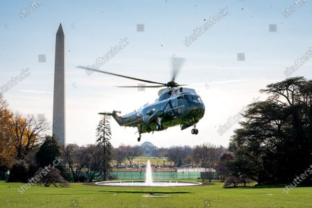 President Donald Trump, joined by grandchildren Arabella Kushner, Theodore Kushner and Joseph Kushner, disembark Marine One on the South Lawn of the White House Sunday, Nov. 29, 2020, returning from Camp David near Thurmont, Md.
