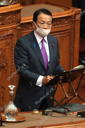 Japanese Finance Minister Taro Aso answers a qustion at Upper House's plenary session at the National Diet in Tokyo on Monday, November 30, 2020.