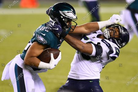 Philadelphia Eagles' Richard Rodgers (85) tries to break free of Seattle Seahawks' K.J. Wright (50) during the second half of an NFL football game, in Philadelphia