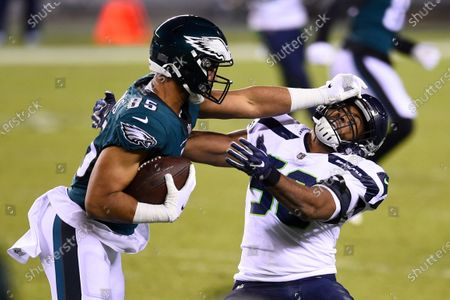 Philadelphia Eagles' Richard Rodgers (85) tries to get past Seattle Seahawks' K.J. Wright (50) during the second half of an NFL football game, in Philadelphia