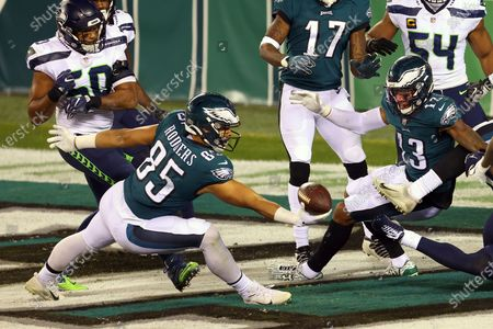 Stock Image of Philadelphia Eagles' Richard Rodgers (85) makes a one handed catch for a 33 yard touchdown on a ball tipped by teammate Travis Fulgham (13) with 12 seconds remaining as Seattle Seahawks' Jamal Adams (33) defends in an NFL football game, in Philadelphia. The Seahawks defeated the Eagles