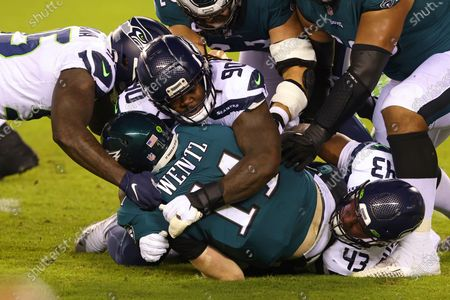 Stock Picture of Philadelphia Eagles quarterback Carson Wentz (11) is sacked by Benson Mayowa (95), Jarran Reed (90) and Carlos Dunlap (43) during the first half of an NFL football game, in Philadelphia. The Seahawks defeated the Eagles