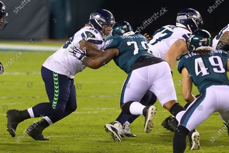 Seattle Seahawks' Damien Lewis (68) in action against the Philadelphia Eagles' T.Y. McGill (76) during an NFL football game, in Philadelphia. The Seahawks defeated the Eagles