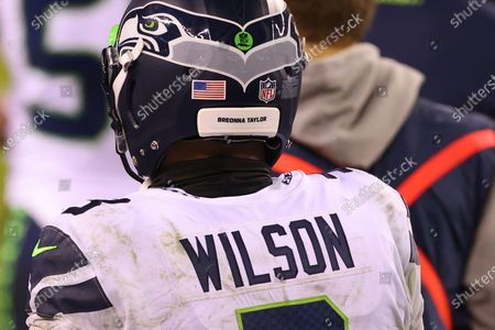 Seattle Seahawks' Russell Wilson (3) has the name of Breonna Taylor on his helmet during an NFL football game against the Philadelphia Eagles, in Philadelphia. The Seahawks defeated the Eagles