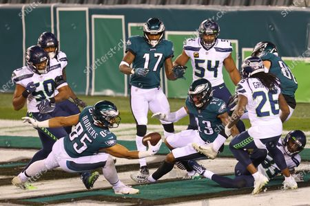 Philadelphia Eagles' Richard Rodgers (85) makes a one handed catch for a 33 yard touchdown on a ball tipped by teammate Travis Fulgham (13) with 12 seconds remaining as Seattle Seahawks' Jamal Adams (33) defends in an NFL football game, in Philadelphia. The Seahawks defeated the Eagles