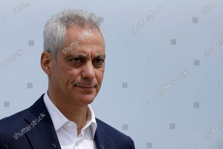 Chicago Mayor Rahm Emanuel waves as he arrives at a news conference outside of the south air traffic control tower at O'Hare International Airport in Chicago