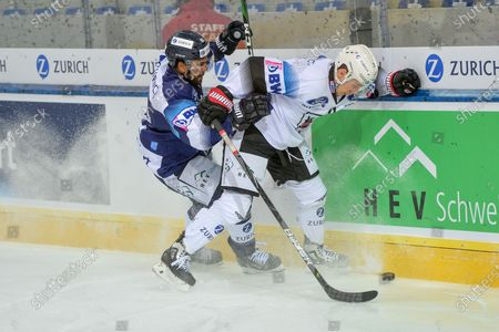 #13 Marco Mueller (Ambri) against #71 Killian Mottet (Fribourg)
