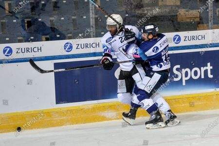 #22 Dave Sutter (Fribourg) against #13 Marco Mueller (Ambri)