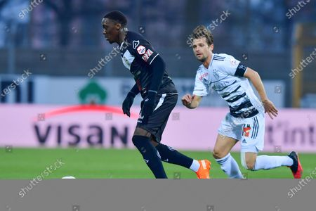 Cristopher Lungoyi (#8 FC Lugano) and Valentin Stocker (#14 FC Basel 1893) in action during the Swiss Super League match between FC Lugano and FC Basel 1893