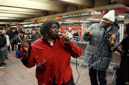 Alice Tan Ridley singing with subway passengers