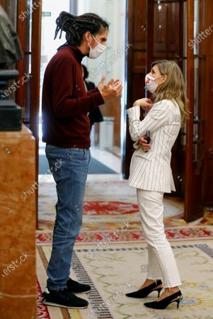 Alberto Rodriguez (L), MP of Spanish Podemos party, chats with Spanish Labor Minister, Yolanda Diaz (R), at the Lower house in Madrid, Spain, during the 2021 Budget Debate at Parliament, 01 December 2020. The 2021 Budget continues with the amendments procedure as the Government has already 186 votes guaranteed and 2 more votes could be soon be achieved after negotiating with Cantabria's Regional Party (PRC)and Teruel Existe.