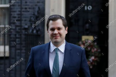 Robert Jenrick, Britain's Secretary of State for Housing, Communities and Local Government walks across Downing Street to attend a cabinet meeting in London, . Members of Parliament will vote later Tuesday on the proposed tier system as the country prepares to come out of lockdown