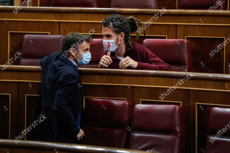 Spanish MP of En Comu Podem party Jaune Asens (L) chats with MP of Unidas Podemos Alberto Rodriguez (R) during the 2021 Budget Debate at Parliament in Madrid, Spain, 01 December 2020. The 2021 Budget continues with the amendments procedure as the Government has already 186 votes guaranteed and two more votes could soon be achieved after negotiating with Cantabria's Regional Party (PRC) and Teruel Existe.