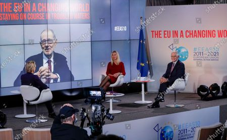European High Representative of the Union for Foreign Affairs and Security Policy (HR/VP) , Josep Borrell (R), and his predecessors Federica Mogherini (2-R, 2014-2019) and Javier Solana (2-L,on screen, 1999-2009) attend an online event to commemorate 10 years since the creation of the European External Action Service EEAS, in Brussels, Belgium 01 December 2020. On left (back to camera) is French journalist Christine Ockrent, who led the event.