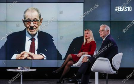 European High Representative of the Union for Foreign Affairs and Security Policy (HR/VP) , Josep Borrell (R), and his predecessors Federica Mogherini (2-R, 2014-2019) and Javier Solana (L,on screen, 1999-2009) attend an online event to commemorate 10 years since the creation of the European External Action Service EEAS, in Brussels, Belgium 01 December 2020.