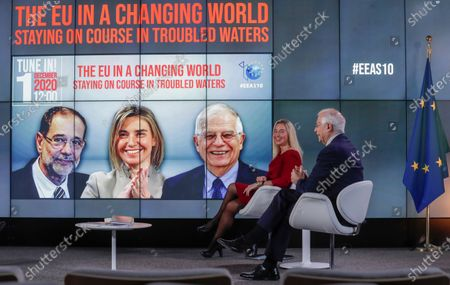 Stock Image of European High Representative of the Union for Foreign Affairs and Security Policy (HR/VP) , Josep Borrell (R), and his predecessors Federica Mogherini (2-R, 2014-2019) attend an online event to commemorate 10 years since the creation of the European External Action Service EEAS, in Brussels, Belgium, 01 December 2020.
