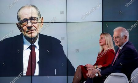 European High Representative of the Union for Foreign Affairs and Security Policy (HR/VP) , Josep Borrell (R), and his predecessors Federica Mogherini (2-R, 2014-2019) and Javier Solana (L,on screen, 1999-2009) attend an online event to commemorate 10 years since the creation of the European External Action Service EEAS, in Brussels, Belgium, 01 December 2020.