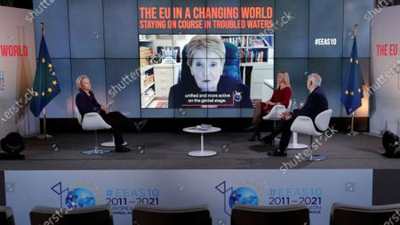 Former US Secretary of State Madeleine Albright (C, on screen) is seen during her video message to European High Representative of the Union for Foreign Affairs and Security Policy (HR/VP), Josep Borrell (R), and his predecessor Federica Mogherini (2-R, 2014-2019) attending an online event to commemorate 10 years since the creation of the European External Action Service EEAS, in Brussels, Belgium, 01 December 2020. On left is French journalist Christine Ockrent, who led the event.