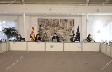 Stock Picture of A handout photo made available by the Spanish Prime Minister's Office shows Spanish Prime Minister Pedro Sanchez (C) chairing the weekly Cabinet Meeting at Moncloa Palace in Madrid, Spain, 01 December 2020.