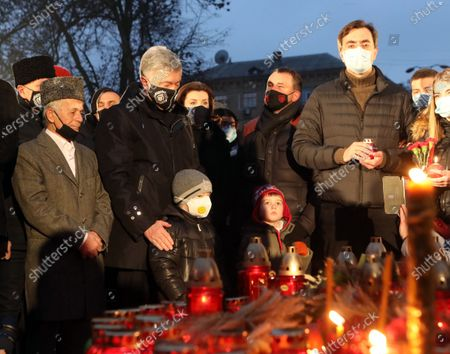 Leader of the Crimean Tatar people Mustafa Dzhemiliev, MP Petro Poroshenko and his wife Maryna Poroshenko (L to R, middle) pay tribute to the victims of the 1932-1933 famine at the National Museum of the Holodomor-Genocide on the Holodomor Victims Remembrance Day, Kyiv, capital of Ukraine.