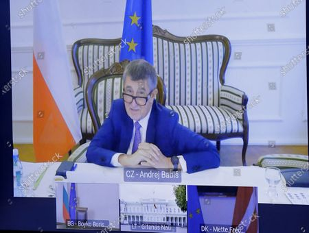 Czech Republic's Prime Minister Andrej Babis, top of screen, participates in a video conference with European Council President Charles Michel, President of Lithuania Gitanas Nauseda, Danish Prime Minister Mette Frederiksen and Bulgaria's Prime Minister Boyko Borissov to prepare for the upcoming EU Summit at the European Council building in Brussels
