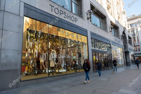 Stock Image of The Topshop flagship store on Oxford Circus on the day before re-opening from the Covid-19 second lockdown.