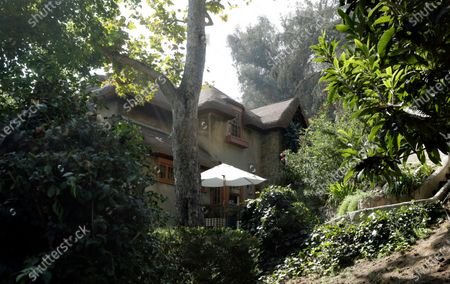 Humphrey Bogart's one-time home in Beachwood Canyon, (Bogart was living in the house when his friend and neighbor Peg Entwistle committed suicide in 1932 by throwing herself off the Hollywood Sign), is included in a driving tour of five different homes in the Los Angeles area that were featured in movies with hobbits/witches. Photographed on Sunday, Oct. 18, 2020 Beachwood Canyon, CA. (Myung J. Chun / Los Angeles Times)