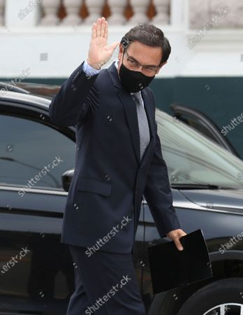 Stock Photo of Former President Martin Vizcarra waves at reporters as he arrives to Congress in Lima, Peru, . Vizcarra is attending a congressional oversight committee to testify in the investigation that is being carried out against him for alleged crimes of corruption related to well-known artist Richard Cisneros