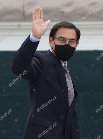 Stock Picture of Former President Martin Vizcarra waves at reporters as he arrives to Congress in Lima, Peru, . Vizcarra is attending a congressional oversight committee to testify in the investigation that is being carried out against him for alleged crimes of corruption related to well-known artist Richard Cisneros