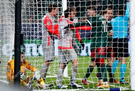 Stock Image of Lokomotiv's Anton Miranchuk (R) points towards Salzburg's goalkeeper Cican Stankovic (L) during the UEFA Champions League group A soccer match between Lokomotiv Moscow and FC Salzburg in Moscow, Russia, 01 December 2020.
