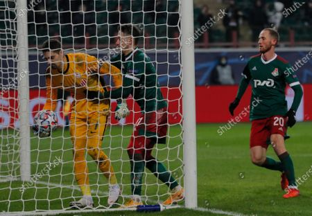 Stock Picture of Lokomotiv players Anton Miranchuk (C) and Vladislav Ignatyev (R) argue with Salzburg's goalkeeper Cican Stankovic (L) during the UEFA Champions League group A soccer match between Lokomotiv Moscow and FC Salzburg in Moscow, Russia, 01 December 2020.