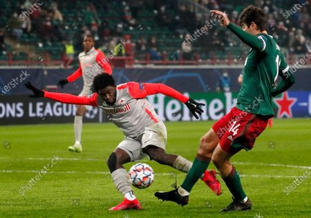 Stock Picture of Salzburg's Sekou Koita (L) in action against Lokomotiv's captain Vedran Corluka (R) during the UEFA Champions League group A soccer match between Lokomotiv Moscow and FC Salzburg in Moscow, Russia, 01 December 2020.