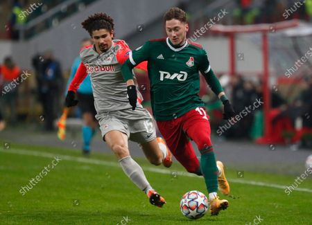 Salzburg's Andre Ramalho, left, and Lokomotiv's Anton Miranchuk challenge for the ball during the Champions League, group A, soccer match between Lokomotiv Moscow and RB Salzburg at the Lokomotiv stadium in Moscow, Russia