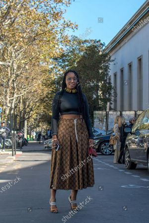 Shiona Turini wears a black crop top, a long skirt by Gucci and high heels by Fendi outside the Dries Van Noten show during Paris Fashion Week Womenswear Spring/Summer 2019