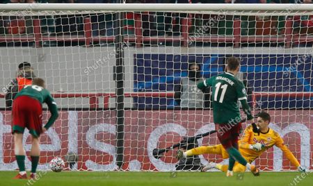 Lokomotiv's Anton Miranchuk (front R) scores a penalty against Salzburg's goalkeeper Cican Stankovic (back R) during the UEFA Champions League group A soccer match between Lokomotiv Moscow and FC Salzburg in Moscow, Russia, 01 December 2020.