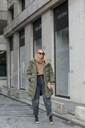 Stock Photo of Roberta Benteler wears a Balenciaga puffer jacket, Celine bag, Isabel Marant jeans a camel turtleneck jumper and two tones stretch boots outside the Y/Project show during Paris Fashion Week Womenswear Fall Winter 2018
