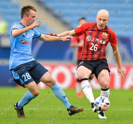 Stock Photo of Aaron Mooy (R) of Shanghai SIPG FC vies with Calem Nieuwenhof of Sydney FC during a Group H football match of the AFC Champions League between Shanghai SIPG FC and Sydney FC in Doha, Qatar, Dec. 1, 2020.