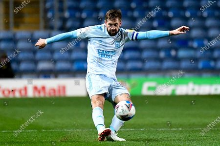 Stock Image of Ipswich Town defender Luke Chambers (4) gets a pass away during the EFL Sky Bet League 1 match between Oxford United and Ipswich Town at the Kassam Stadium, Oxford