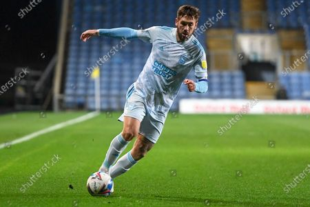 Stock Photo of Ipswich Town defender Luke Chambers (4) sprints forward with the ball during the EFL Sky Bet League 1 match between Oxford United and Ipswich Town at the Kassam Stadium, Oxford