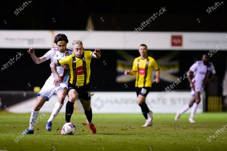 Stock Photo of Scunthorpe United Alex Gilliead (8) Harrogate Town Calvin Miller (19) battles for possession during the EFL Sky Bet League 2 match between Harrogate Town and Scunthorpe United at the EnviroVent Stadium, Harrogate
