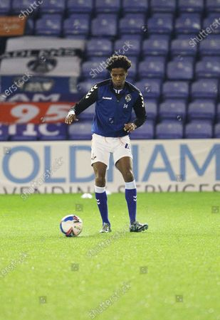 Oldham Athletic defender Sido Jombati (4) warm up during the EFL Sky Bet League 2 match between Oldham Athletic and Tranmere Rovers at Boundary Park, Oldham