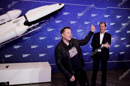 SpaceX owner and Tesla CEO Elon Musk (L) poses as Axel Springer's Chairman of the Board Mathias Doepfner (R) looks on after arriving on the red carpet for the Axel Springer award, in Berlin, Germany, 01 December 2020.