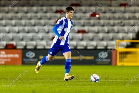 Stock Photo of Wigan Athletic Defender Tom Pearce (3) during the EFL Sky Bet League 1 match between Lincoln City and Wigan Athletic at Sincil Bank, Lincoln