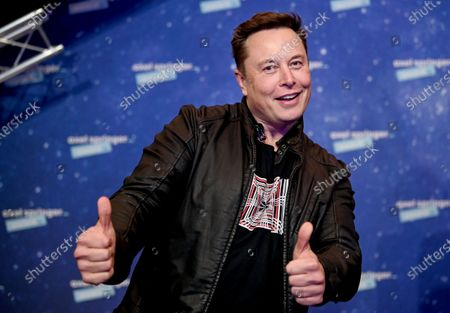 SpaceX owner and Tesla CEO Elon Musk poses after arriving on the red carpet for the Axel Springer award, in Berlin, Germany, 01 December 2020.